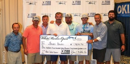 group of men holding big check for second place winner for white marlin open